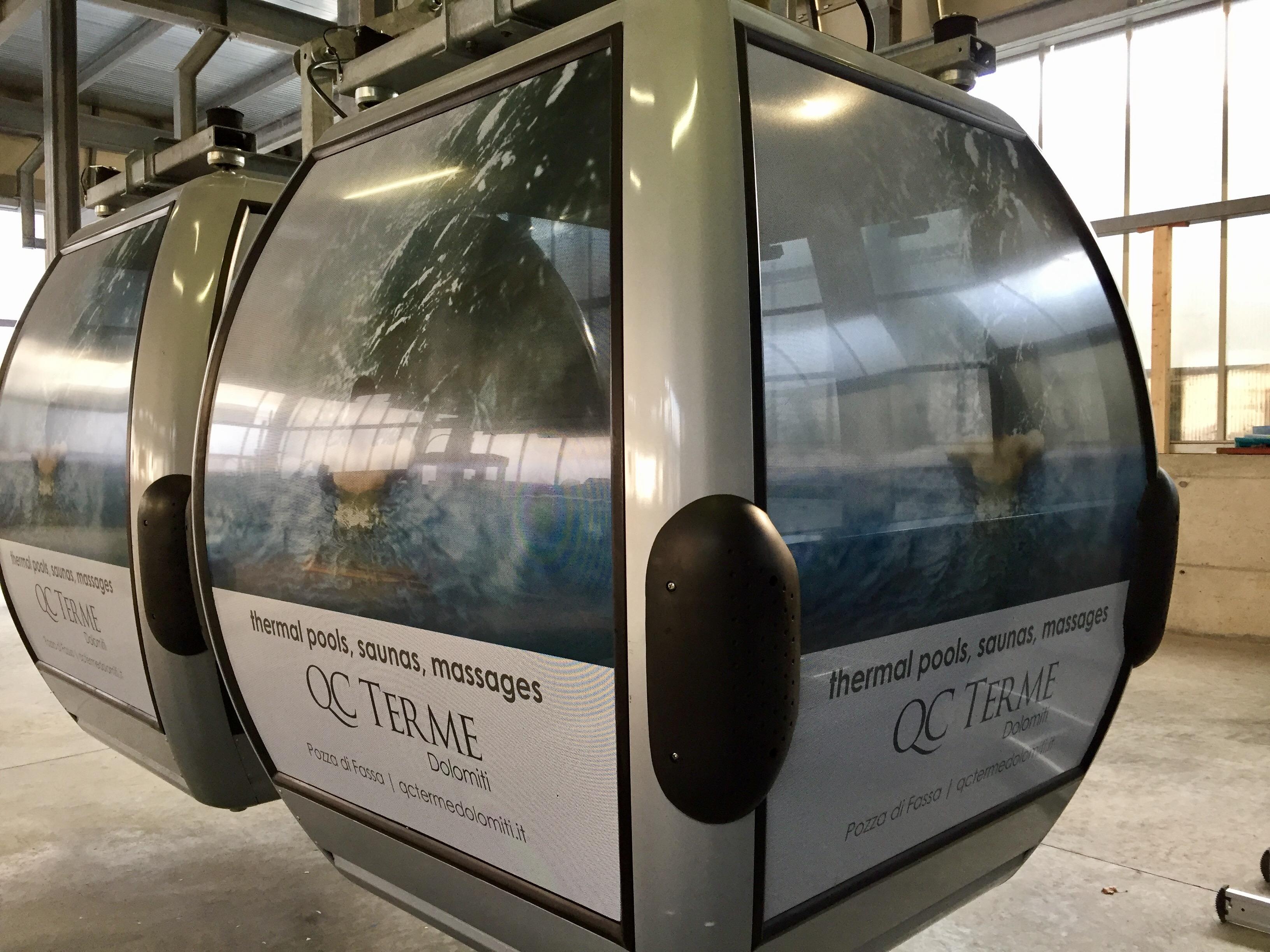Allestimento cabinovie per QC Terme Dolomiti