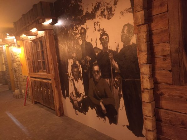 Allestimento adesivo effetto stucco – Hotel Arnika